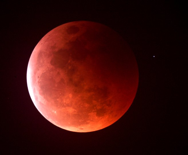 A red tinged Moon as seen during a total lunar eclipse.