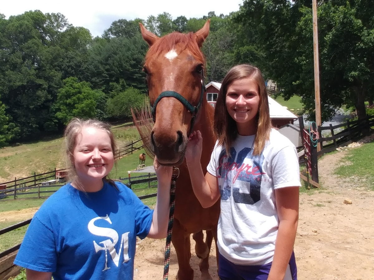 SCC upward bound students with horse.