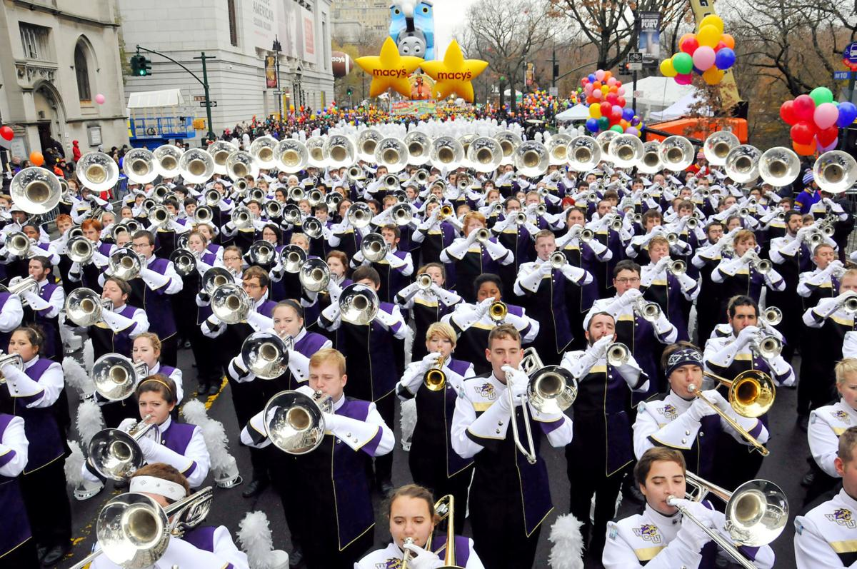 The WCU Marching Band dressed in purple and white leading the Macy's Thanksgiving Day Parade.