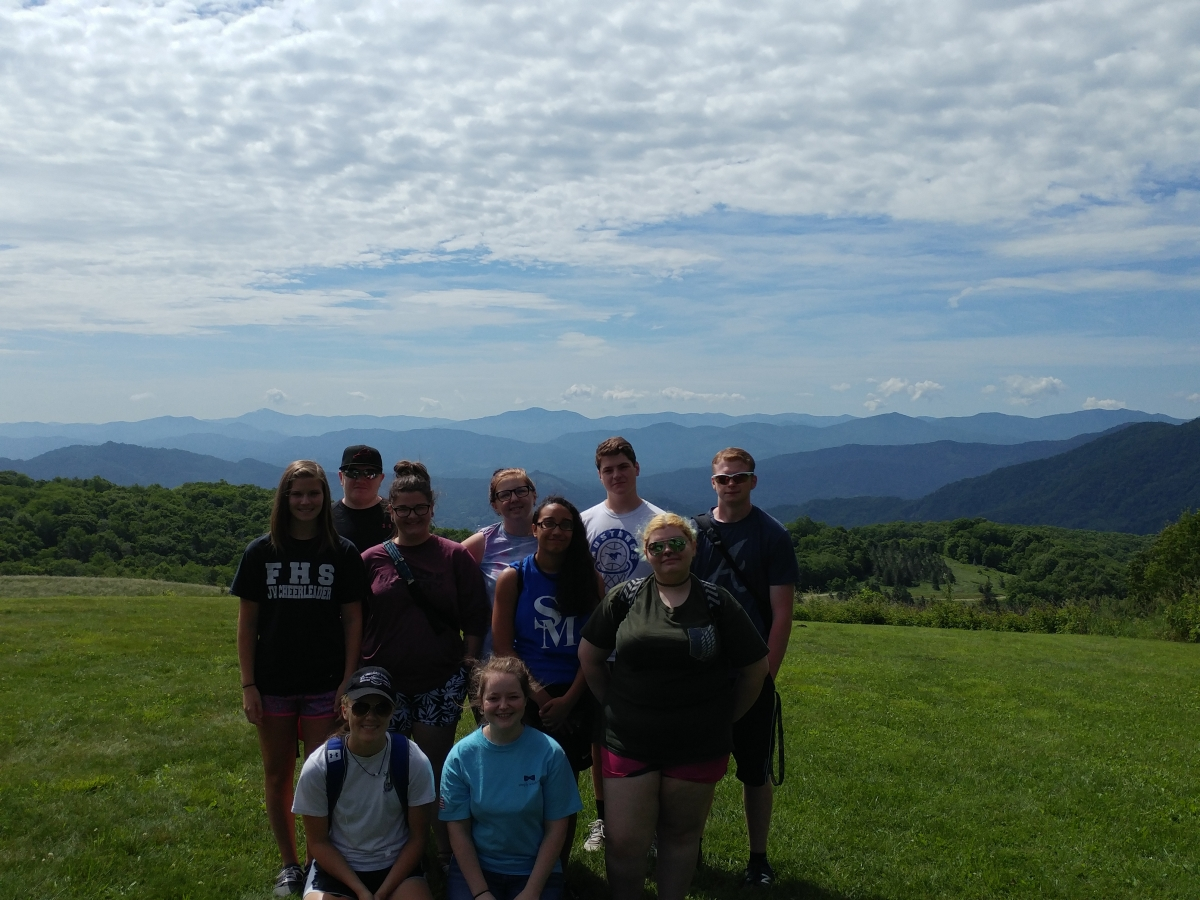 Upward Bound students outside with mountains behind them