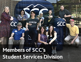 Enrollment services team sits on and around SCC's huge inflatable couch