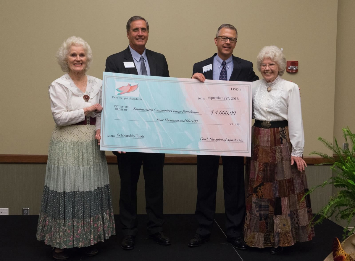 Catch the Spirit of Appalachia cofounders present $4,000 toward their endowed scholarship with SCC. Pictured from left are: Doreyl Ammons Cain of Catch the Spirit, Dr. Don Tomas, president of SCC; Brett Woods, director of the SCC Foundation; and Amy Ammons Garza of Catch the Spirit
