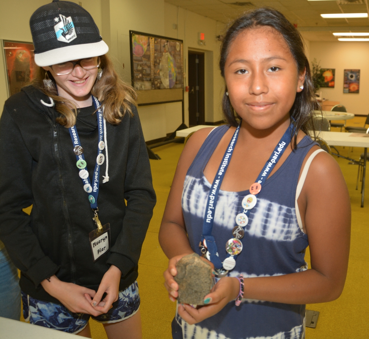 Two students hold space rocks