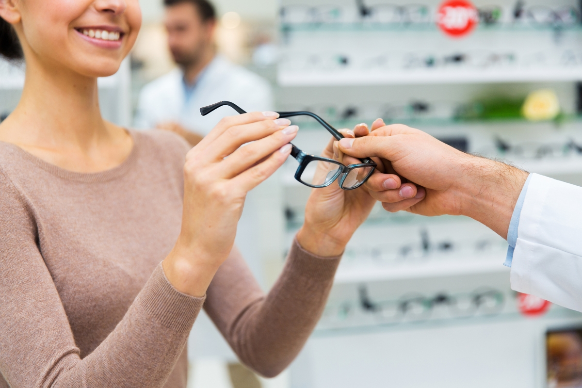 Woman receives pair of eyeglasses