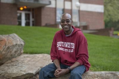 Man sitting on a rock