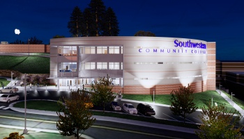 Artist's rendering of the new building, shown at night, three story structure with several parking spots out front.