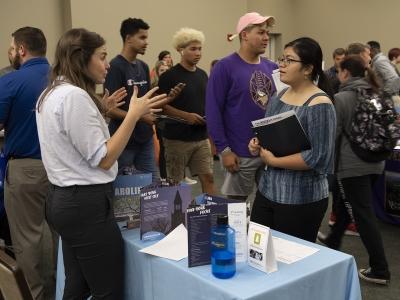 Two people interacting at a job fair