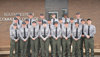 NPS-SLET graduates pose for picture before graduation ceremony.