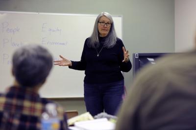 Photo of teacher talking to a class.